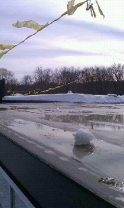 A six-man crew cleared the Hunking School roof on Thursday and created channels to keep water flowing to roof drains.