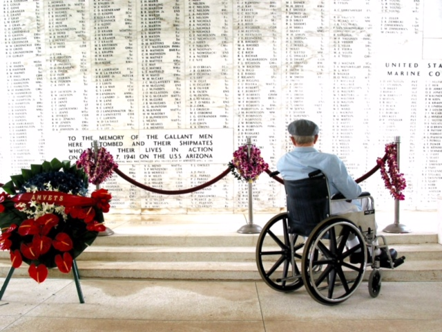 Reading the names of the casualties at Pearl Harbor.